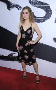 Haley Lu Richardson paired her cute frock with black ankle-strap heels.