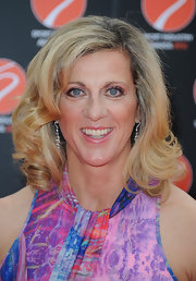 Sally Gunnell wore her hair in big bouncy curls at the Sport Industry Awards.