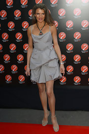 Annabel Croft looked chic and beautiful in a gray tiered bubble-hem dress.
