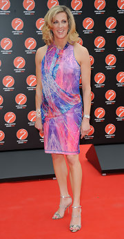Sally Gunnell looked vibrant at the Sport Industry Awards in a colorful printed drape dress.