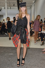 Chiara Ferragni was edgy-chic at the Sportmax fashion show in her black cutout boots, LBD, and leather jacket.