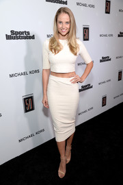 Genevieve Morton flaunted her tiny waist in a white knit crop-top at the Sports Illustrated 2017 Fashionable 50 celebration.