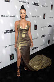 Draya Michele looked va-va-voom in a low-cut gold fishtail gown by Anya Liesnik at the Sports Illustrated 2017 Fashionable 50 celebration.