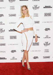 Erin Heatherton went risque in a perforated pencil skirt during the Sports Illustrated Swimsuit 2016 celebration.