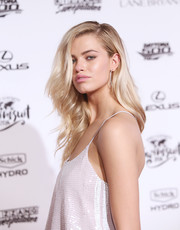 SI Swimsuit model Hailey Clauson opted for elegance with dangling diamond earrings.