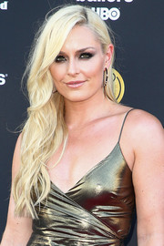 Lindsey Vonn looked ultra feminine with her long blonde waves at the Sports Illustrated Fashionable 50 event.