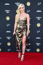 Lindsey Vonn paired her dress with black ankle-wrap sandals.