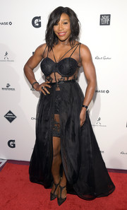 Serena Williams layered a black maxi skirt over her corset dress for a slightly less racy look.