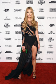 Nina Agdal added some color to her look via a printed box clutch.