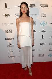 Lily Aldridge tied her look together with a pair of strappy nude heels by Giuseppe Zanotti.