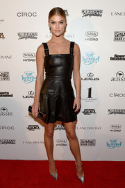 Nina Agdal made leather look so darling with this black apron dress she wore to the Sports Illustrated Swim BBQ.