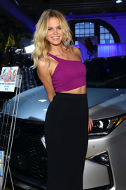 Erin Heatherton teamed a magenta one-shoulder crop-top with a black pencil skirt for the Sports Illustrated Swim City event.