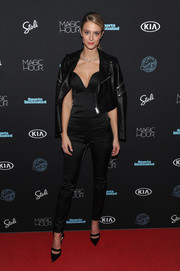 Kate Bock went for a rocker-chic finish with a black leather jacket.