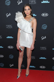 Olivia Culpo completed her look with silver ankle-strap pumps.
