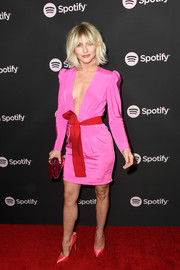 Julianne Hough looked flirty in a plunging hot-pink dress with a red bow belt at the Spotify Best New Artist 2019 event.