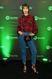 Jackie Cruz kept it ladylike up top in a long-sleeve red print blouse at the Soundtrack de Mi Vida campaign celebration.