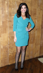 Kimberly Guilfoyle's wrap dress and black patent leather pumps were an ageless combination.