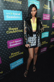 Chanel Iman teamed a Fausto Puglisi studded leather jacket with a halter crop-top for an edgy-sexy vibe at the Sprint Sound Sessions.