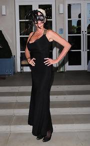 Brigitte Nielsen opted for a simple black evening gown with pops of gold for her masked ball look.