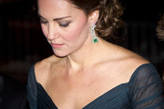 Kate Middleton attended the St. Andrews anniversary dinner wearing a stunning pair of emerald and diamond chandelier earrings.