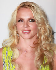 Britney Spears added some bounce to her blond locks with lustrous curls. she completed her look with light makeup and a swipe of lip gloss.
