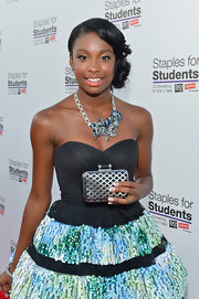 Coco Jones dazzled at the Staples School Supply Drive with an intricate gemstone-encrusted necklace.