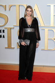 Kitty Spencer was sexy-glam in a sheer black gown with a bedazzled waistband, neckline, and cuffs at the UK premiere of 'A Star is Born.'