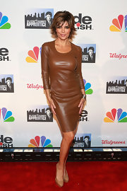 Lisa Rinna showed off her figure with this brown fitted leather dress.