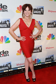 Marilu Henner chose this red bandage dress for her sexy and mature red carpet look at the the finale of 'All-Star Celebrity Apprentice.'