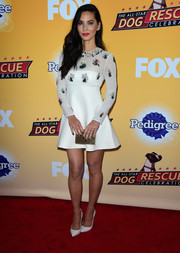 Olivia Munn kept it demure in a Valentino long-sleeve fit-and-flare dress with a flower-embroidered bodice at the All-Star Dog Rescue celebration.