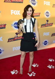 Emmy Rossum attended the All-Star Dog Rescue celebration wearing a monochrome mini dress featuring a printed bodice and a flared black skirt.