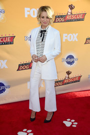 Kaley Cuoco suited up in this white jacket and wide-leg pants combo for the All-Star Dog Rescue celebration.