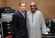 Leonardo DiCaprio wore a blue blazer while posing with Stevie Wonder in Sydney.