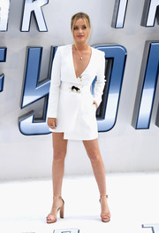 Laura Whitmore completed her sleek ensemble with a pair of dusty-rose platform sandals.