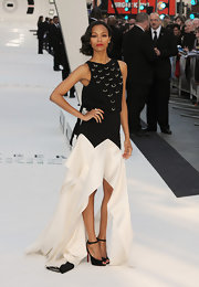 Zoe Saldana stunned again in this black-and-white dress with an embellished bodice and a flowing fishtail skirt.