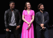 Daisy stood out on stage in this bright pink frock.