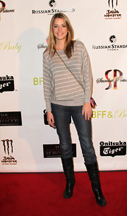 Julie Gonzalo looked casual in slouchy jeans paired with black leather mid-calf boots. A striped sweater completed the look.
