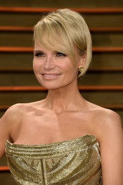 Kristin Chenoweth complemented her glamorous gown with a cute short 'do with side-swept bangs when she attended the Vanity Fair Oscar party.