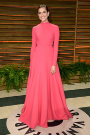 Allison Williams kept it modest yet elegant in a high-neck, long-sleeve pink gown by Emilia Wickstead during the Vanity Fair Oscar party.