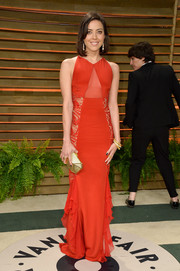 Aubrey Plaza looked mildly sexy at the Vanity Fair Oscar party in a red Emilio Pucci gown with a sheer midriff panel.