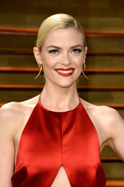Jaime King went for sleek styling with this side-parted chignon during the Vanity Fair Oscar party.
