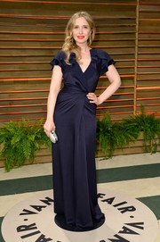 Julie Delpy cut a girly silhouette in a navy wrap dress with ruffle sleeves during the Vanity Fair Oscar party.