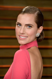 Allison Williams pulled her hair back into an elegant side-parted chignon for the Vanity Fair Oscar party.