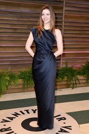 Talulah Riley went for modern glamour in an asymmetrical navy evening dress during the Vanity Fair Oscar party.