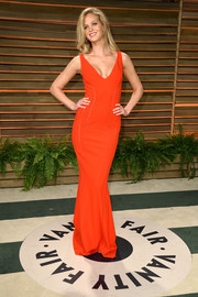 Erin Heatherton put her fab curves on display in a tight-fitting red Antonio Berardi gown during the Vanity Fair Oscar party.