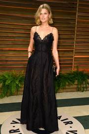 Toni Garrn opted for a lingerie-inspired black gown by Elie Saab for the Vanity Fair Oscar party.