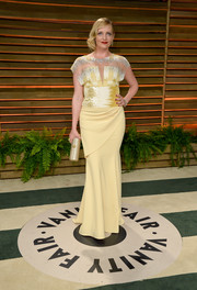 Marley Shelton donned a vintage-chic yellow evening dress with a beaded bodice for the Vanity Fair Oscar party.