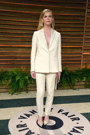 Brooklyn Decker looked sharp and sexy at the Vanity Fair Oscar party in a white Calvin Klein pantsuit with no shirt underneath.
