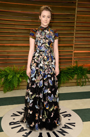 Saoirse Ronan was demure and ladylike in a high-neck butterfly-print gown by Valentino during the Vanity Fair Oscar party.