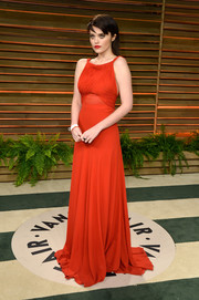 Sky Ferreira chose a sophisticated, floor-sweeping red gown by Saint Laurent for the Vanity Fair Oscar party.